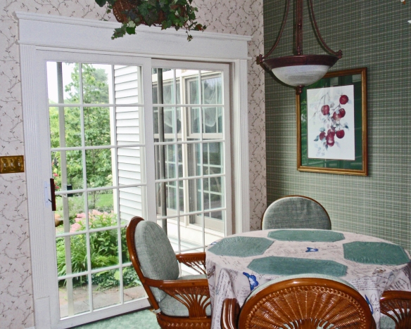 Here is a shot of my kitchen with both wallpapers -- plaid and vines.