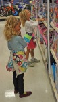 Granddaughters making shopping decisions.
