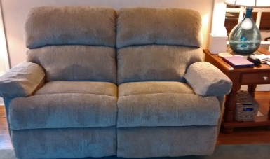New pristine loveseat